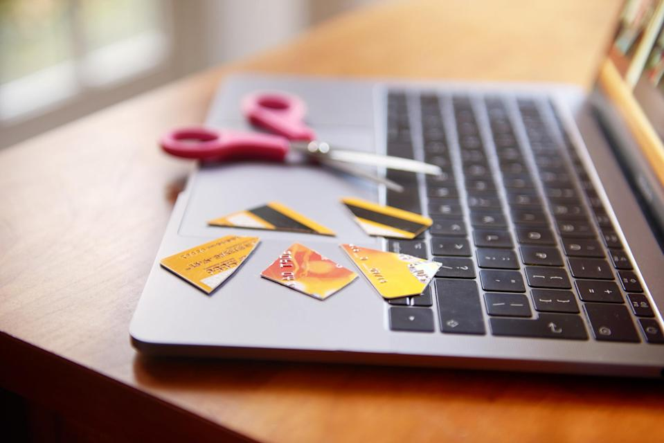Cut-up credit card on a laptop keyboard