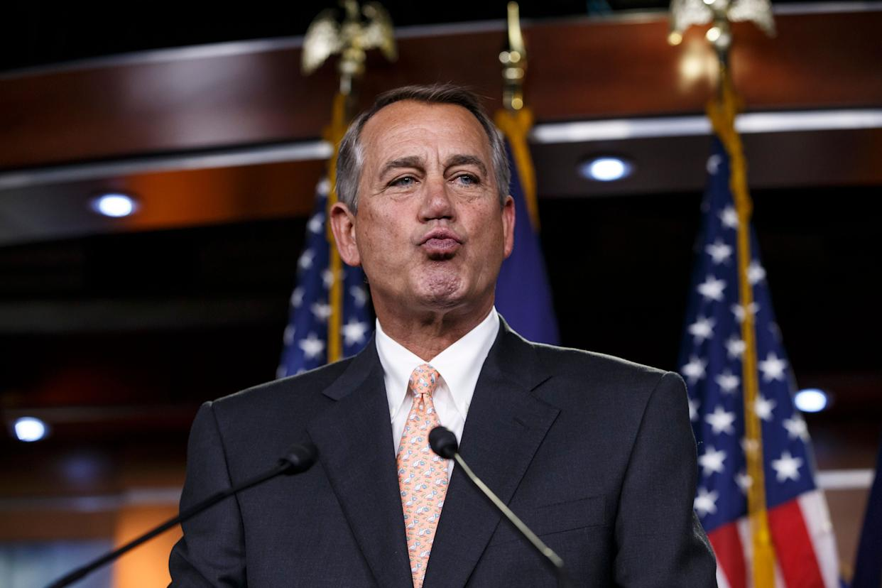 House Speaker John Boehner (R-Ohio) responds to reporters about the impasse over passing the Homeland Security budget because of Republican efforts to block President Barack Obama's executive actions on immigration on Feb. 26, 2015, during a news conference on Capitol Hill in Washington.
