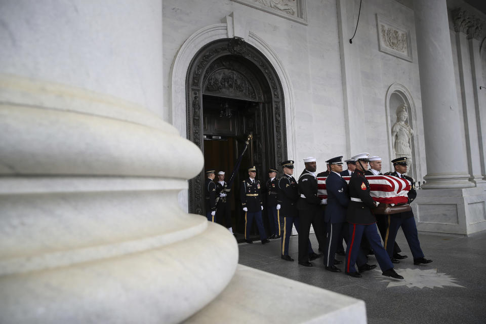 The flag-draped casket of former President George H. W. Bush is carried by a joint services military honor guard out of the Capitol, Wednesday, Dec. 5, 2018, in Washington. (Photo: Win McNamee/Pool via AP)