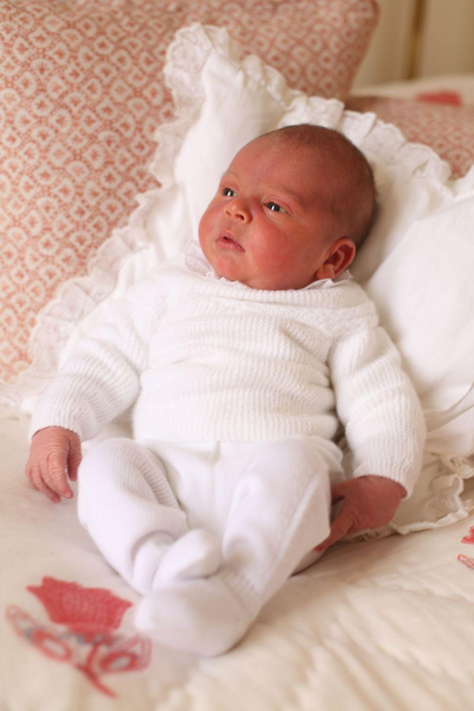 "<p>Prince Louis made his public debut <a href=""https://www.townandcountrymag.com/society/tradition/a26990385/prince-harry-meghan-markle-pose-hospital-royal-baby-history-photos/"" rel=""nofollow noopener"" target=""_blank"" data-ylk=""slk:on the Lindo Wing steps just hours after being born"" class=""link rapid-noclick-resp"">on the Lindo Wing steps just hours after being born</a>, but the first official portraits of Will and Kate's third child were a bit more intimate. Kate photographed her newborn baby at home, at Kensington Palace. </p>"