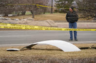 A piece of debris from a commercial airplane is surrounded by police tape on a strip along Midway Boulevard in Broomfield, Colo., after the plane shed parts while making an emergency landing at nearby Denver International Airport Saturday, Feb. 20, 2021. (AP Photo/David Zalubowski)