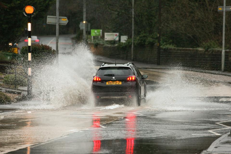 A car seen splashing water as it moves on a waterlogged street during a heavy rainfall in Holmfirth. Parts of the UK including South Yorkshire and Greater Manchester are on high alert as Storm Christoph brings heavy rain, which is expected to cause floods and widespread disruption. (Photo by Adam Vaughan / SOPA Images/Sipa USA)
