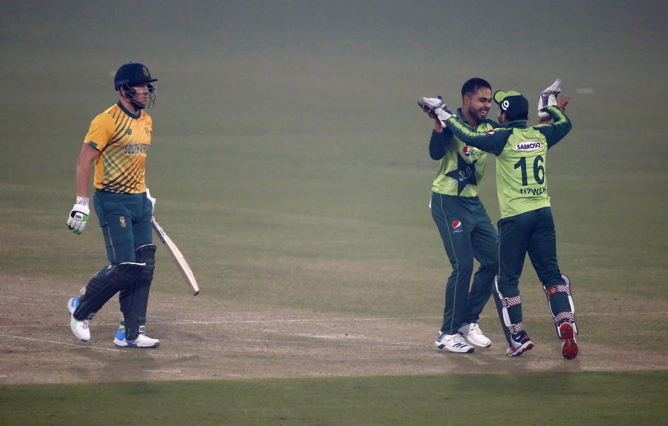 Pakistan's Faheem Ashraf, second right, celebrates with teammate Mohammad Rizwan, right, after taking the wicket of South Africa's David Miller, left, during the 1st Twenty20 cricket match between Pakistan and South Africa at the Gaddafi Stadium, in Lahore, Pakistan, Thursday, Feb. 11, 2021. (AP Photo/K.M. Chaudary)