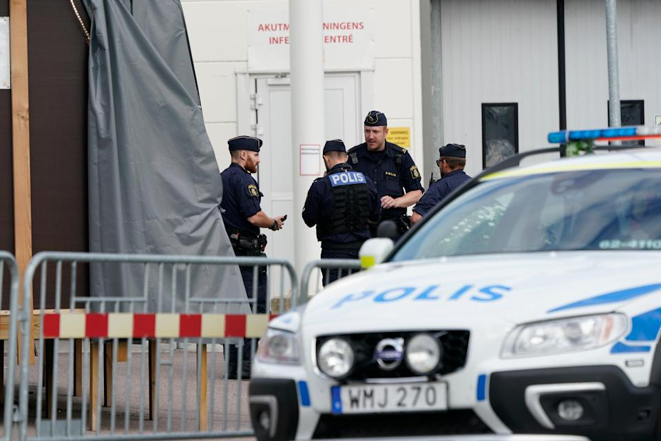 Police monitor the area at the scene of a shooting in Kristianstad (EPA)