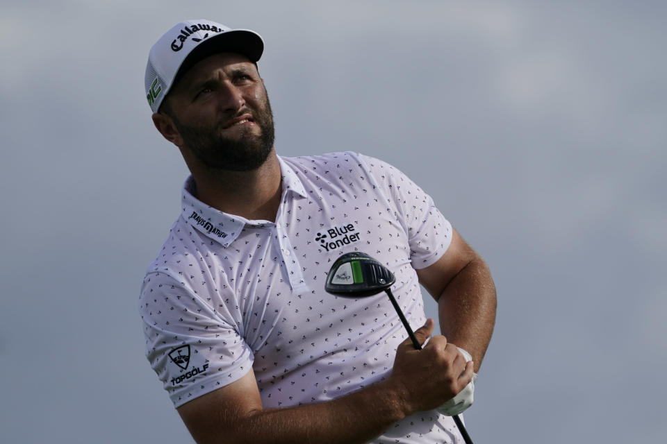 Jon Rahm, of Spain, watches his shot off the 15th tee in the third round at the Northern Trust golf tournament, Saturday, Aug. 21, 2021, at Liberty National Golf Course in Jersey City, N.J. (AP Photo/John Minchillo)
