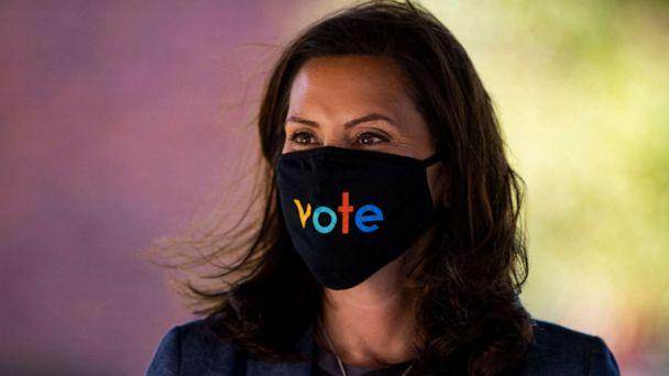 PHOTO: Michigan Gov. Gretchen Whitmer wears a mask with the word 'vote' displayed on the front during a roundtable discussion on healthcare, Oct. 7, 2020, in Kalamazoo, Mich. (Nicole Hester/Ann Arbor News via AP)