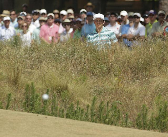Rickie Fowler chips to the green sixth hole during the third round of the U.S. Open golf tournament in Pinehurst, N.C., Saturday, June 14, 2014. (AP Photo/Charlie Riedel)