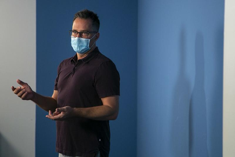 Casting director Ross Lacy wears a mask as he prepares for in-person auditions.
