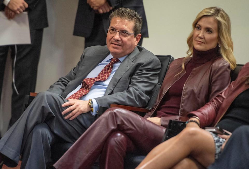 Washington owner Daniel Snyder and his wife Tanya look on as head coach Ron Rivera speaks during his introductory press conference at Inova Sports Performance Center.