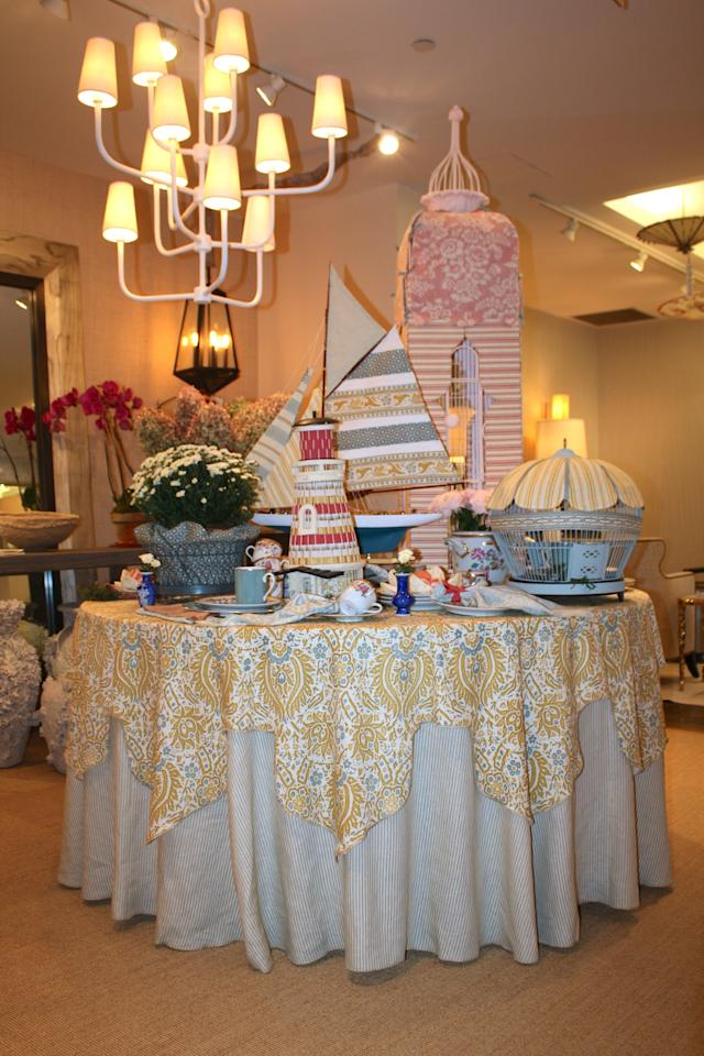 Erick Espinoza of Tony Barratta layered two Le Gracieux fabrics for a double dose of pattern and then topped off the table with an array of nautical-themed decor.