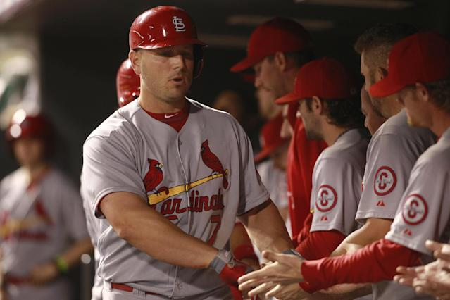 Teammates line up to congratulate St. Louis Cardinals' Matt Holliday as he returns to the dugout after hitting a two-run home run against the Colorado Rockies in the fifth inning of the Cardinals' 11-4 victory in a baseball game in Denver on Tuesday, Sept. 17, 2013. (AP Photo/David Zalubowski)