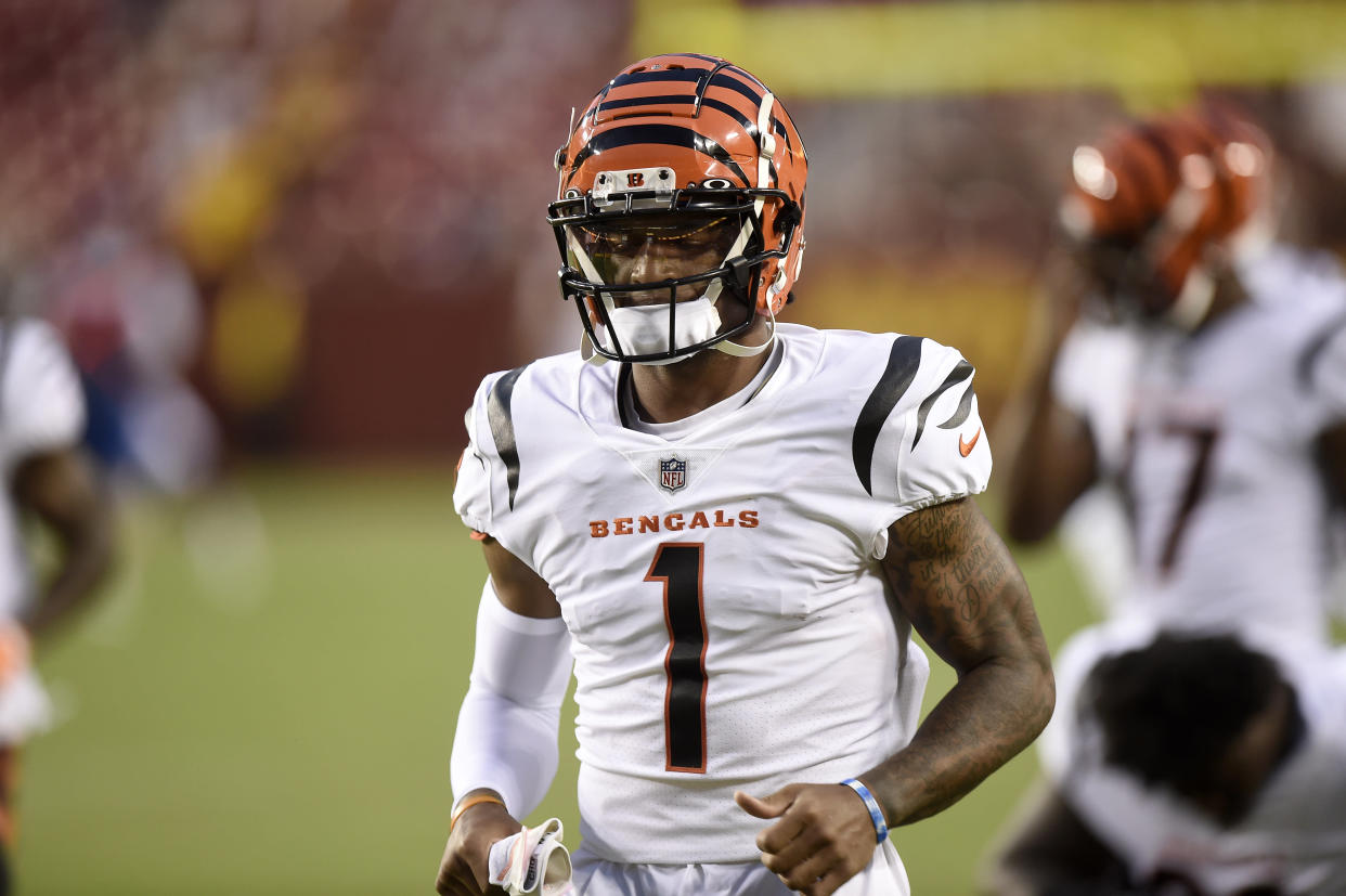 LANDOVER, MARYLAND - AUGUST 20: Ja'Marr Chase #1 of the Cincinnati Bengals runs onto the field before the NFL preseason game against the Washington Football Team at FedExField on August 20, 2021 in Landover, Maryland. (Photo by Greg Fiume/Getty Images)