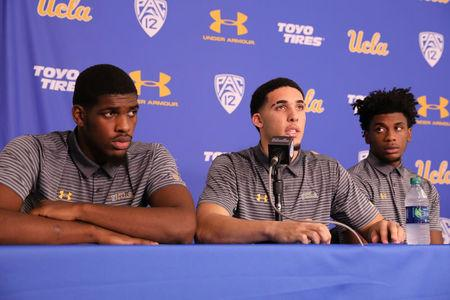 UCLA basketball players Cody Riley, LiAngelo Ball and Jalen Hill speak at a press conference at UCLA after flying back from China, where they were detained on suspicion of shoplifting, in Los Angeles, California. REUTERS/Lucy Nicholson