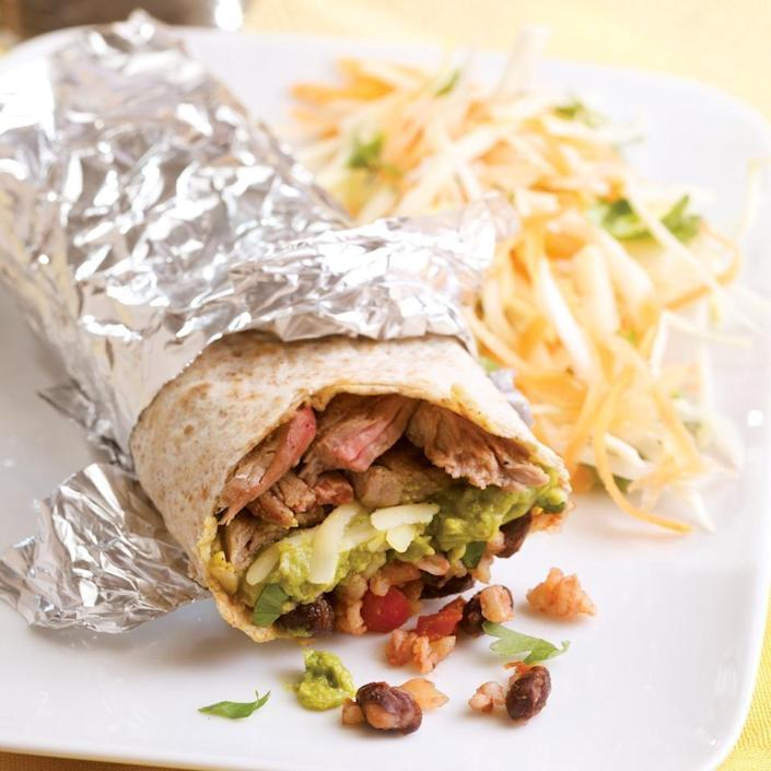 <p>Here's a burrito inspired by San Francisco's super burritos that come packed with meat, beans, rice, cheese, guacamole and salsa. We've kept this home-style version a bit simpler to make and a whole lot healthier with brown rice, whole-wheat tortillas and a more reasonable serving size. We recommend wrapping it in foil--the traditional way to serve it--so you can pick the burrito up and eat it without it falling apart, peeling back the foil as you go. Serve with a cold beer and vinegar-dressed slaw.</p>
