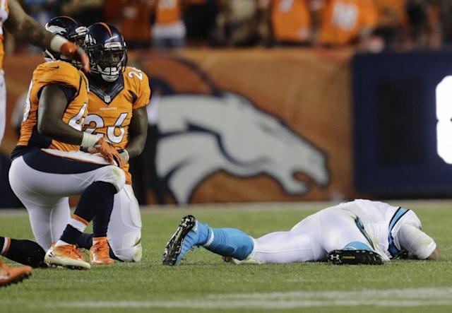 Cam Newton took four head shots in Thursday's loss to Denver, the last one the most damaging. (AP)