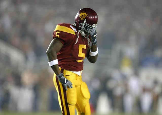 "USC's Reggie Bush is dejected after fumbling in second quarter action against the <a class=""link rapid-noclick-resp"" href=""/ncaab/teams/tal/"" data-ylk=""slk:Texas Longhorns"">Texas Longhorns</a> at the national championship game at the Rose Bowl Game in Pasadena, Wednesday, Jan. 4, 2006. (Getty Images)"