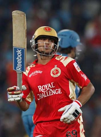 Royal Challengers Bangalore's Manish Pandey celebrates his century against Deccan Chargers during their 2009 Indian Premier League cricket match in Pretoria, South Africa, Thursday May 21, 2009. (AP Photo/Aman Sharma)