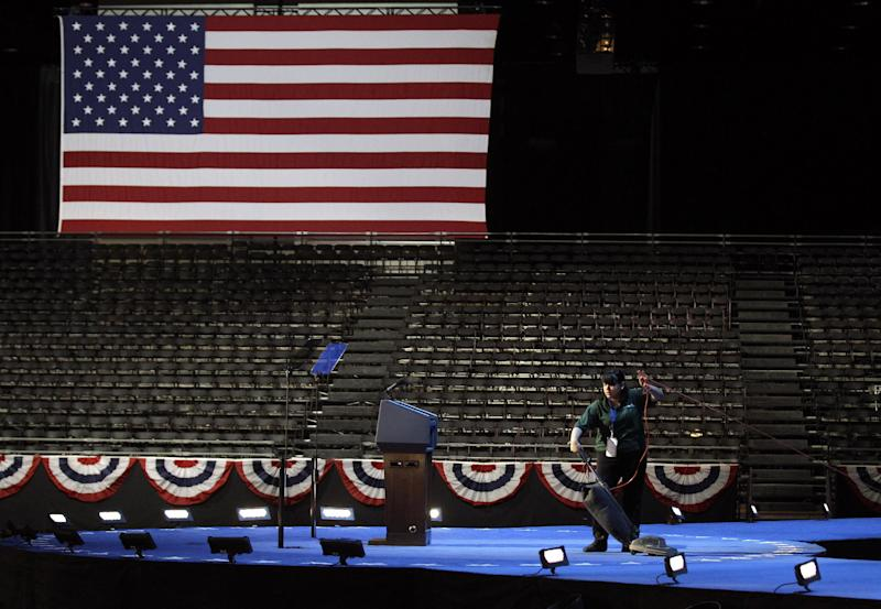 The stage is vacuumed as last minute preparations continue for President Barack Obama's election night party Tuesday, Nov. 6, 2012, in Chicago. (AP Photo/M. Spencer Green)
