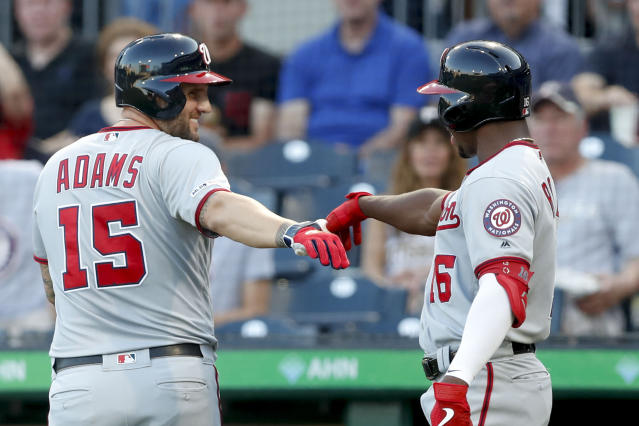 Washington Nationals' Matt Adams (15) is greeted by on-deck batter Victor Robles after hitting a two-run home run against the Pittsburgh Pirates in the first inning of a baseball game, Monday, Aug. 19, 2019, in Pittsburgh. (AP Photo/Keith Srakocic)