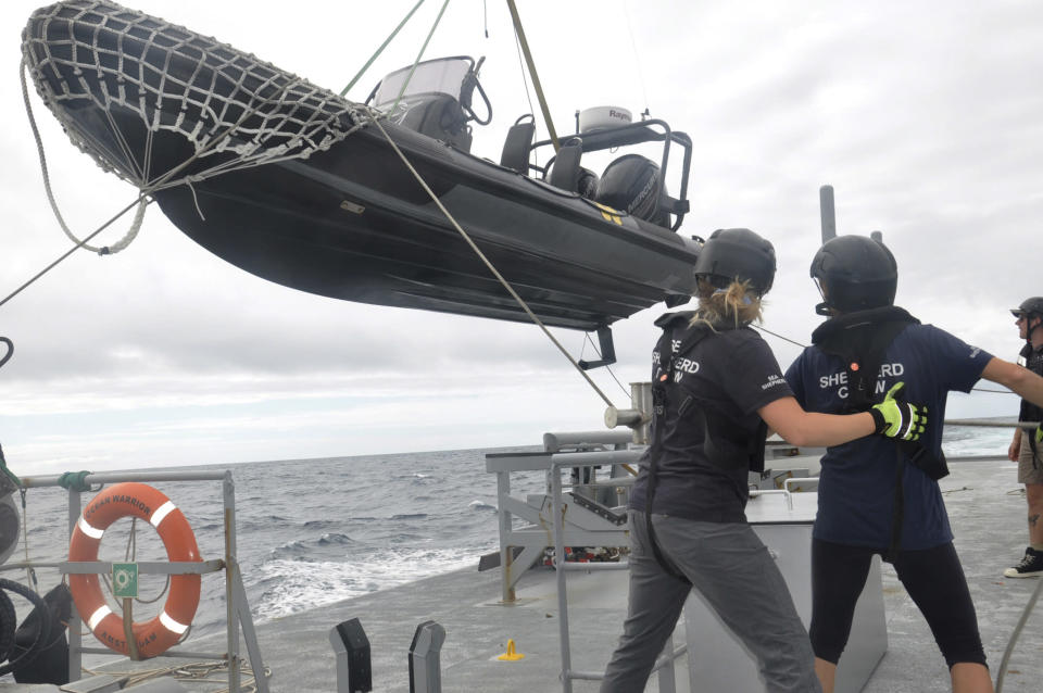 Members of Sea Shepherd, an ocean conservation group, lower an inflatable dinghy from the deck of the Ocean Warrior off the west coast of South America on July 17, 2021. Activists are seeking restrictions on fishing as part of negotiations underway on a first-ever High Seas Treaty, which could dramatically boost international cooperation on the traditionally lawless waters that comprise nearly half of the planet. (AP Photo/Joshua Goodman)