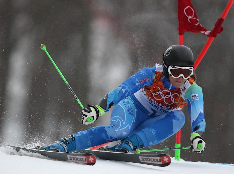 Slovenia's Tina Maze passes a gate in the first run of the women's giant slalom at the Sochi 2014 Winter Olympics, Tuesday, Feb. 18, 2014, in Krasnaya Polyana, Russia.(AP Photo/Alessandro Trovati)