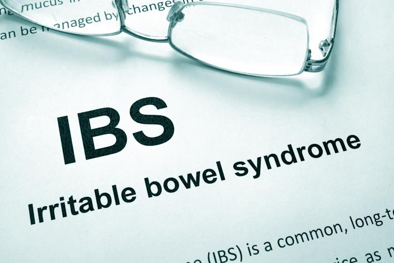 Paper with words Irritable bowel syndrome (IBS) and glasses.