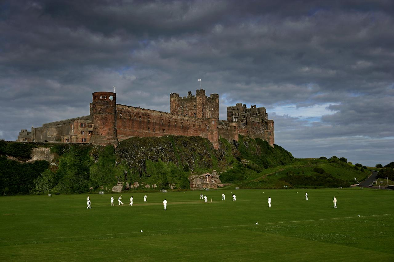 BAMBURGH, ENGLAND - JULY 13: Cricketers from Bamburgh Castle Cricket Club play at the foot of Bamburgh Castle on July 13, 2008 in Bamburgh, England.  (Photo by Laurence Griffiths/Getty Images)