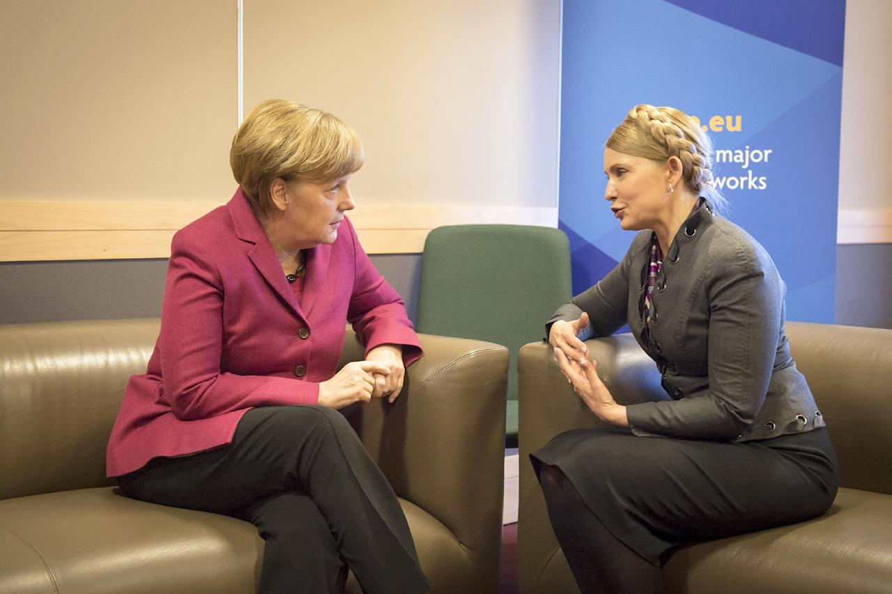 In this picture provided by the German government German Chancellor Angela Merkel, left, meets with Ukrainian politician Yulia Tymoshenko. right, on the occasion of a meeting of the European peoples parties in Dublin, Ireland, Friday, March 7, 2014. (AP Photo/German Government/Guido Bergmann)
