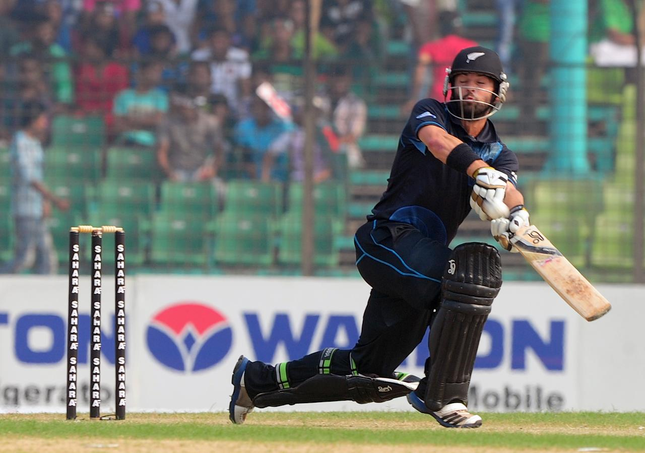 New Zealand batsman Anton Devcich plays a shot during the third One-Day International (ODI) cricket match between Bangladesh and New Zealand at Khan Jahan Ali Stadium in Fatullah, on the outskirts of Dhaka on November 3, 2013. AFP PHOTO/ Munir uz ZAMAN        (Photo credit should read MUNIR UZ ZAMAN/AFP/Getty Images)