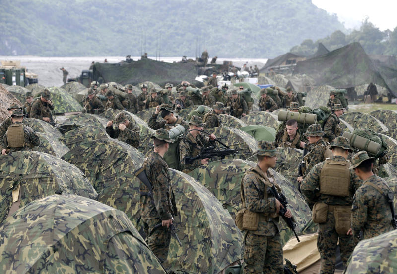 FILE - In this Oct. 9 2012 file photo U.S. Marines fix their & APNewsBreak: US Philippines reach deal on troops