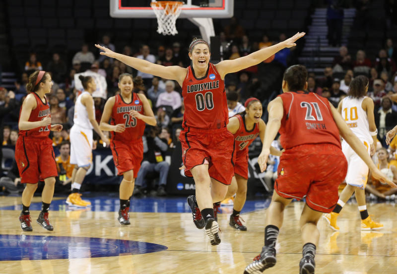 Louisville guard Jude Schimmel (22), guard Shoni Schimmel (23), forward Sara Hammond (00), guard Antonita Slaughter (4) and guard Bria Smith (21) celebrate the team's 86-78 victory over Tennessee in the regional final in the NCAA women's college basketball tournament in Oklahoma City, Tuesday, April 2, 2013. (AP Photo/Sue Ogrocki)