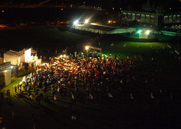 Crowd braves the rain at the PAP's rally on an open field on Rivervale Crescent in Punggol East.