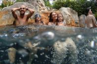Rotem and Dani, newly-arrived tourists from Israel, enjoy in a jacuzzi as Phuket reopens to overseas tourists, in Thailand