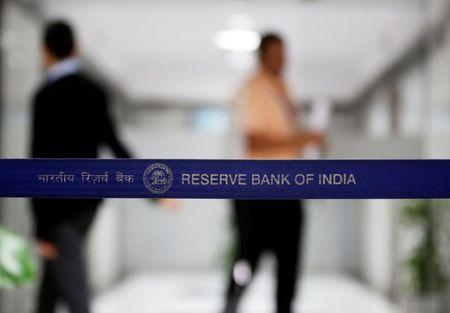 People walk past a barricade inside the Reserve Bank of India (RBI) headquarters in Mumbai, June 7, 2017. REUTERS/Shailesh Andrade/Files