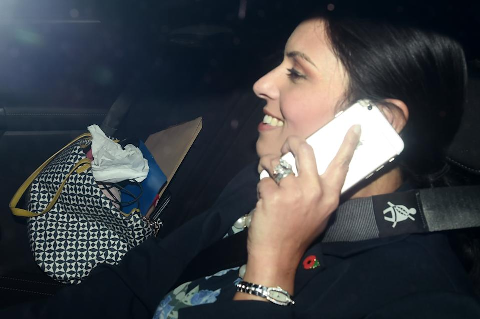 LONDON, ENGLAND - NOVEMBER 08: British Secretary of State for International Development Priti Patel talks on a mobile phone in a car as she arrives to Downing Street on November 8, 2017 in London, England. Ms Patel has been summoned back to the U.K from an official trip to Uganda as more details of her unofficial meetings with Israeli officials emerge. (Photo by Carl Court/Getty Images)
