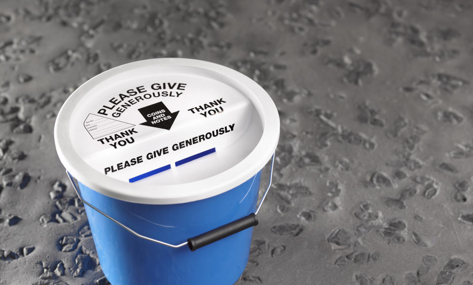 Charity collection bucket on road