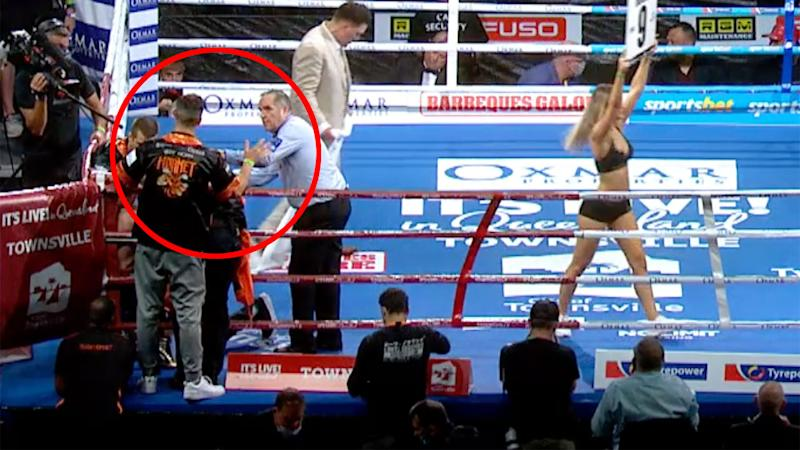 Pictured here, Jeff Horn's cornerman waves for the referee to stop the fight.