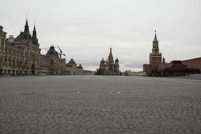 A view of an empty Red square, with the St. Basil's Cathedral, center, and Kremlin's Spasskaya Tower, right, in Moscow, Russia, Monday, March 30, 2020. Moscow Mayor Sergei Sobyanin ordered all city residents except for those working in essential sectors to stay home starting Monday. Residents are allowed to buy food and medicines at nearby stores and pharmacies and walk their dogs in close vicinity. (AP Photo/Pavel Golovkin)