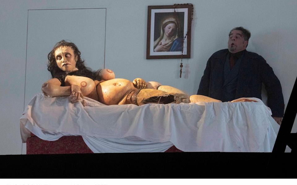 Carlos Álvarez as RIgoletto with the grotesque doll left in Gilda's wake, in the Royal Opera's production - Alastair Muir