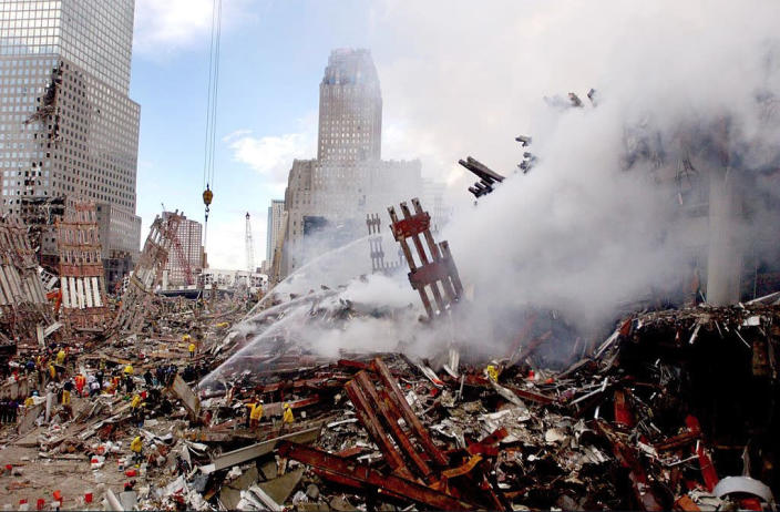 <p>Fires still burning amid the rubble of the World Trade Center three days after the Sept. 11 terrorist attacks. (Photo: Mai/Getty Images) </p>