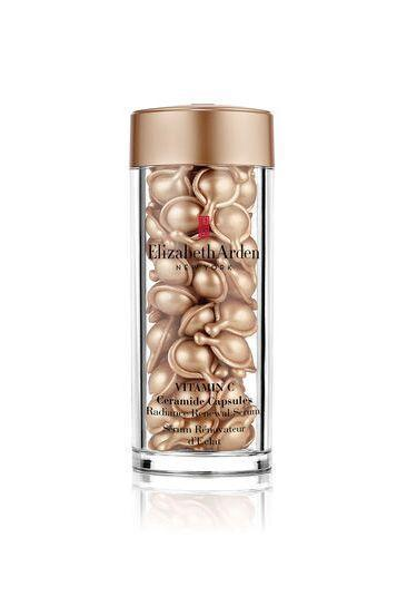 """<p><strong>Elizabeth Arden</strong></p><p>ulta.com</p><p><strong>$87.00</strong></p><p><a href=""""https://go.redirectingat.com?id=74968X1596630&url=https%3A%2F%2Fwww.ulta.com%2Fvitamin-c-ceramide-capsules-radiance-renewal-serum%3FproductId%3Dpimprod2008897&sref=https%3A%2F%2Fwww.oprahmag.com%2Fbeauty%2Fg28640232%2Fbest-vitamin-c-serums%2F"""" rel=""""nofollow noopener"""" target=""""_blank"""" data-ylk=""""slk:Shop Now"""" class=""""link rapid-noclick-resp"""">Shop Now</a></p><p>""""This is the Rolls Royce of vitamin C serums,"""" says <a href=""""http://www.allisondep.com/"""" rel=""""nofollow noopener"""" target=""""_blank"""" data-ylk=""""slk:Allison Depriestre"""" class=""""link rapid-noclick-resp"""">Allison Depriestre</a>, a professional makeup artist in Paris. """"It brightens your skin instantly."""" It also contains ceramides to help retain moisture—a big benefit for anyone with dry skin. The capsules also make this product great for travel, so your skin will always look radiant.</p>"""