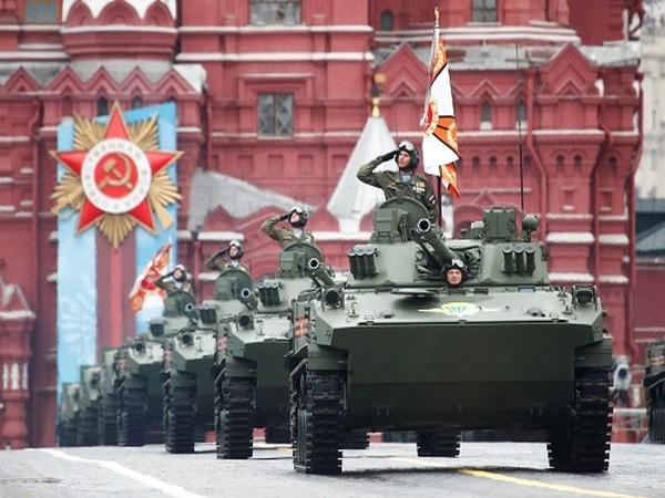 Russian service members drive BMD-4M infantry fighting vehicles during a military parade on Victory Day, in Red Square in central Moscow, Russia May 9, 2021. (Photo credit: REUTERS)