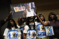 Family members of Byron Williams, from left, niece Teena Acree, brother Ellis Magee, niece Marcia Wells, sister Robyn Williams, and sister Tina Lewis-Stevenson hold up a picture of Byron Williams during a news conference, Thursday, July 15, 2021, in Las Vegas. The family of 50-year-old Byron Williams, whose death in Las Vegas police custody after a bicycle chase in 2019 was ruled a homicide, is suing the city and four officers they accuse of wrongful death and civil rights violations. (AP Photo/John Locher)