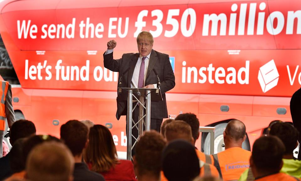 Boris Johnson campaigns in front of a Vote Leave bus (Ben Birchall/PA) (PA Archive)