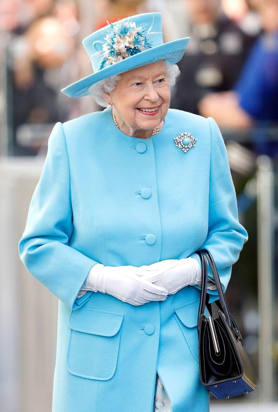 <p>First, white gloves have simply always been a part of the Queen's signature style; would it really seem like the Queen if you didn't see that white-gloved wave? Reason number two is simple: protecting her hands. After all, you shake a lot of hands when you're the Queen!</p>