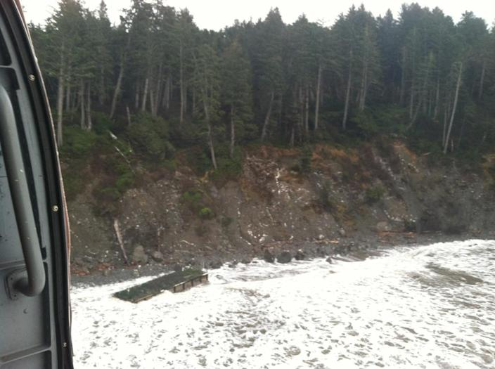 This image provided by the U.S. Coast Guard shows a large ocean-drifting dock that washed ashore in an extremely rugged and remote section of coast in the Olympic National Park Tuesday Dec. 18, 2012. It was found between LaPush and the mouth of the Hoh River. The Coast Guard mounted a series of flights to locate the dock after it was spotted adrift in the ocean last Friday by fishermen aboard Fishing Vessel Lady Nancy. The National Oceanic and Atmospheric Administration worked to determine the dock's trajectory based on the reported location at the time of the sighting. It has not been confirmed whether the dock is a piece of debris from the devastating March 2011 tsunami in Japan. (AP Photo/U.S. Coast Guard)