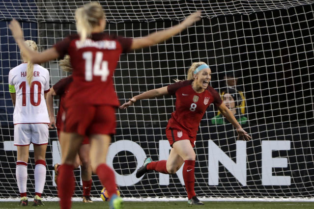Julie Ertz (R) reacts after scoring against Denmark during the first half of an international friendly soccer match. (AP)