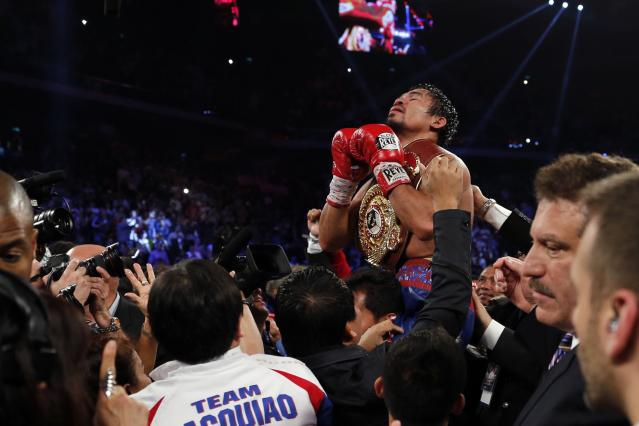 Manny Pacquiao of the Philippines celebrates his victory over Brandon Rios of the U.S. during their World Boxing Organisation (WBO) International 12-round welterweight boxing title fight at the Venetian Macao hotel in Macau November 24, 2013. Pacquiao registered a decisive, unanimous decision win against American Rios to clinch the vacant WBO International welterweight title on Sunday. REUTERS/Tyrone Siu (CHINA - Tags: SPORT BOXING)