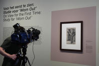 """A cameraman takes pictures of Study for """"Worn Out"""", a drawing by Dutch master Vincent van Gogh, dated Nov. 1882, on public display for the first time at the Van Gogh Museum in Amsterdam, Netherlands, Thursday, Sept. 16, 2021. (AP Photo/Peter Dejong)"""