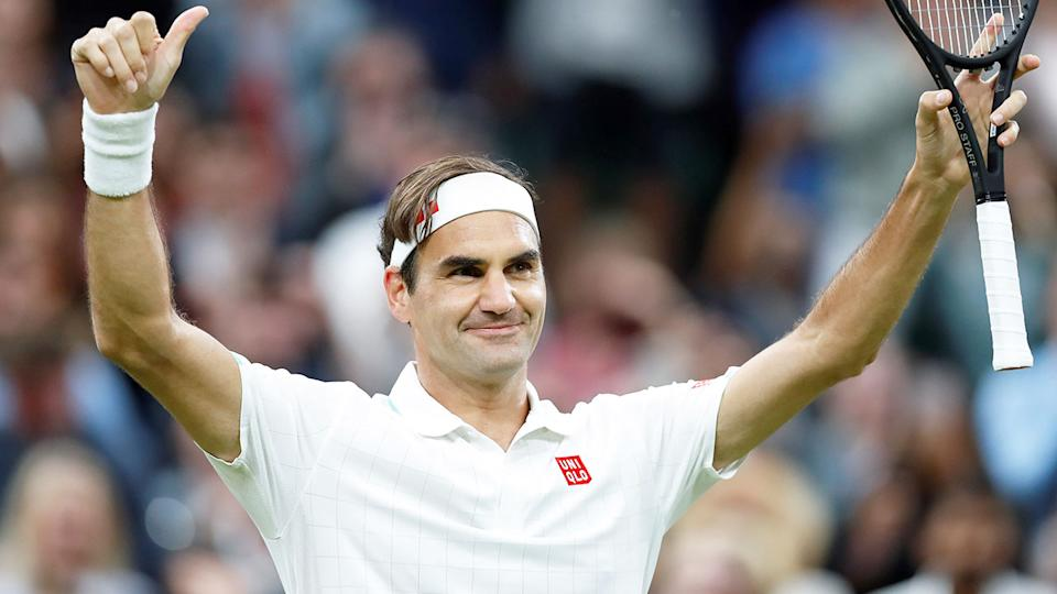 This picture shows Roger Federer celebrating a win at the 2021 Wimbledon Championships.
